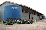 Op elke hoek van het eerste schoolgebouw werden 4 watertanks van gebouwd