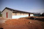 Timmeren van de dakspanten voor de 3de slaapzaal